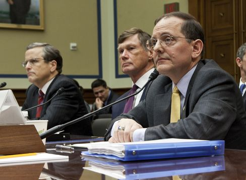 Edward DeMarco, acting director of the Federal Housing Finance Agency, right, listens during a House Oversight and Government Reform Committee hearing on executive compensation in Washington, D.C. Photographer: Brendan Smialowski/Bloomberg