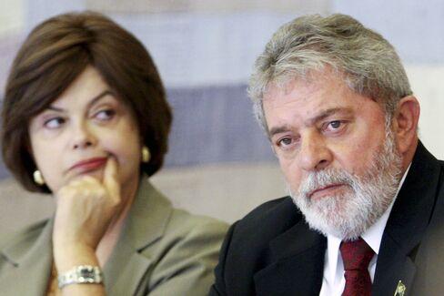 Brazilian President Luiz Inacio Lula da Silva, right