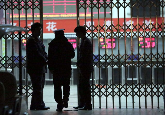 A police officer at the Kunming railway station after the attack. Is this China's '9/11'? Photographer: STR/AFP/Getty Images