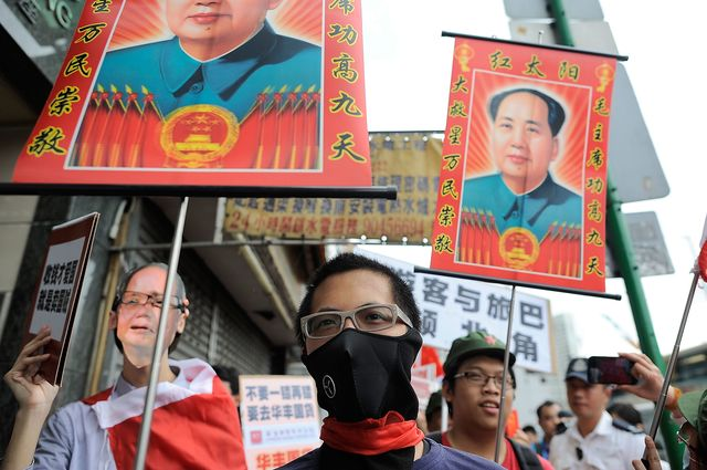 Hong Kong locals protest the influx of mainland Chinese tourists. Photographer:Anthony Kwan/Getty Images News.