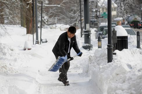 A man shovels snow in Wellesley, Massachusetts