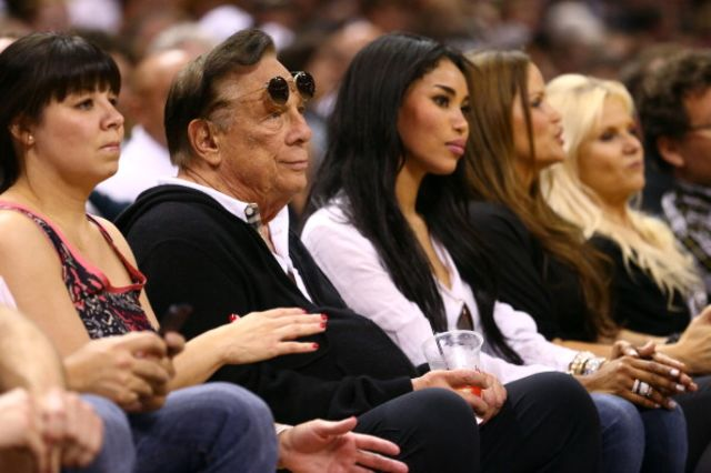 Donald Sterling and V. Stiviano having a silent moment. Photographer: Ronald Martinez/Getty Images