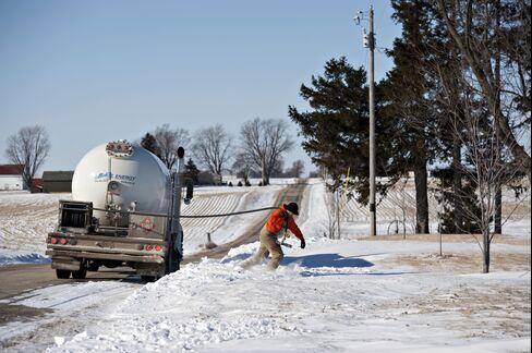 A Liquid Fuels Technician Delivers Propane in the Snow