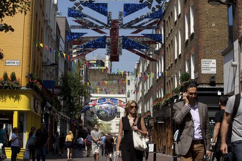 Pedestrians Pass Stores On Carnaby Street In London