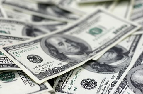 Traders Slash Bets Against Dollar by Record