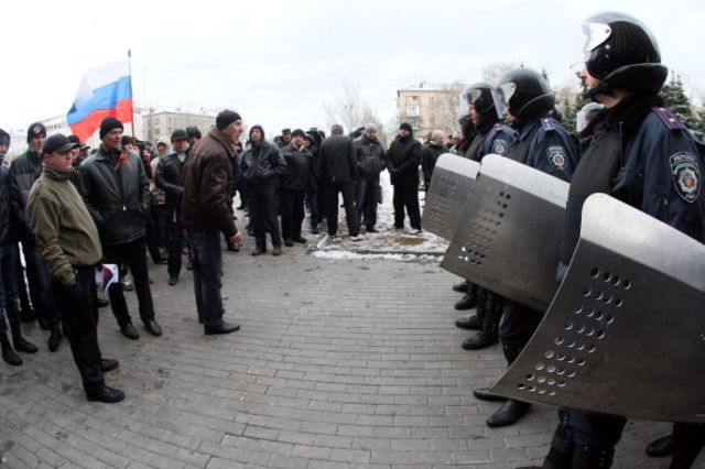 Pro-Russian activists rally Monday at a government building in Donetsk, Ukraine. Photographer: Alexander Khudoteply/AFP/Getty Images