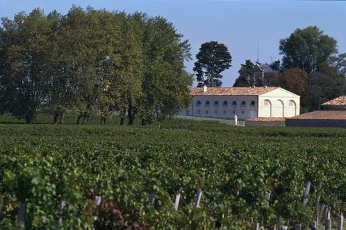 The vineyards and chateau of Mouton Rothschild stand in the Bordeaux region of France. Source: Rothschild SA via Bloomberg