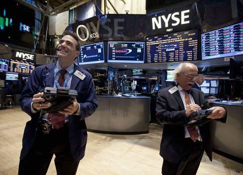 U.S. Stocks Rally After Fed Announces Cuts to Monthly Stimulus