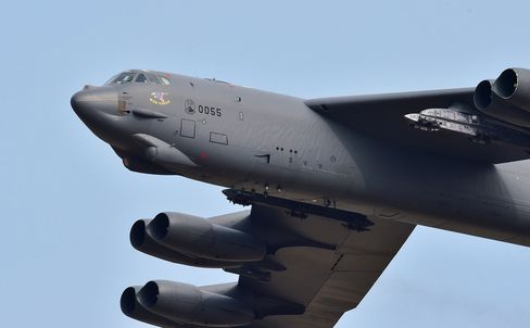 A US B-52 Stratofortress flies over the Osan Air Base in Pyeongtaek, south of Seoul, on January 10, 2016. The US sent a heavy bomber over South Korea on January 10 in a show of force as North Korean leader Kim Jong-Un insisted his country's latest nuclear test was carried out in self-defence. AFP PHOTO / JUNG YEON-JE / AFP / JUNG YEON-JE        (Photo credit should read JUNG YEON-JE/AFP/Getty Images)