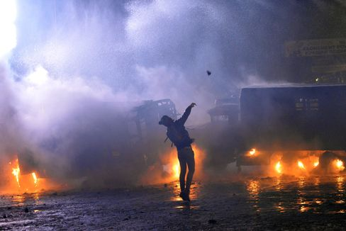 A Protester Throws a Stone During a Clash with Police in Kiev