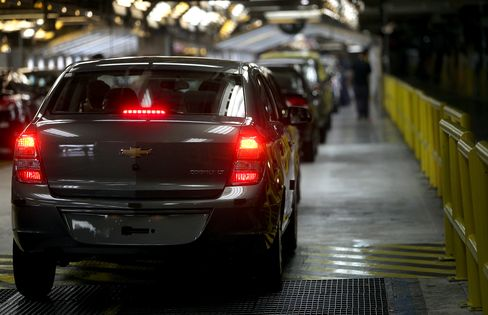 A GM Cobalt Vehicle Moves Along The Assembly Line