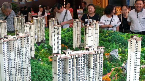 Chinese home buyers visiting a housing fair in Yichang, in China's Hubei province.