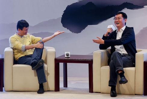 Jack Ma, Chairman of Alibaba Group, and 'Pony' Ma Huateng, Chairman and CEO of Tencent Holdings in 2013.