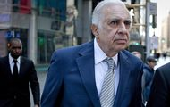 Carl Icahn, billionaire investor and chairman of Icahn Enterprises Holdings LP, left, walks outside of the Nasdaq MarketSite with Robert Greifeld, chief executive officer and president of Nasdaq OMX Group Inc., in New York, U.S., on Tuesday, March 27, 2012. Icahn announced his intention last month to offer $30 a share and give CVR Energy Inc. holders a right to as much as an additional $7 a share, a proposal that values the company at at least $2.6 billion, according to Bloomberg calculations. Photographer: Scott Eells/Bloomberg *** Local Caption *** Carl Icahn; Robert Greifeld