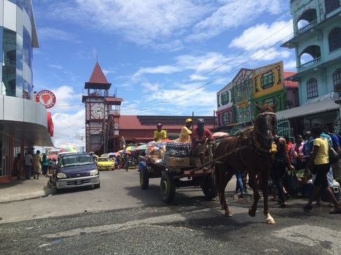 Vendors head to the market in Georgetown, Guyana. Photographer: Andrew Rosati