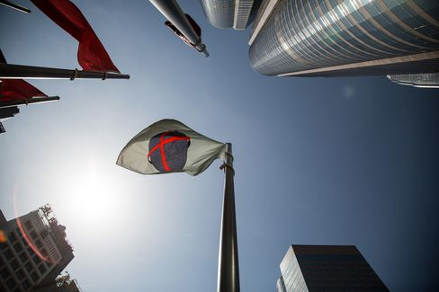 The Hong Kong Exchanges & Clearing Ltd. (HKEx) flag flies outside Exchange Square in Hong Kong, China.
