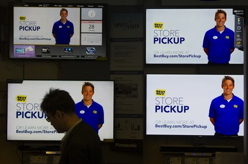 A Customer Browses Televisions at a Best Buy Co. Store