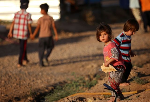 <p>Displaced Iraqis at a camp near Erbil.</p> Photographer: SAFIN HAMED/AFP/Getty Images