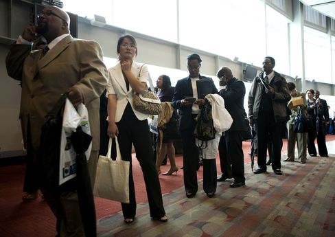 People wait in line at a job fair in Washington