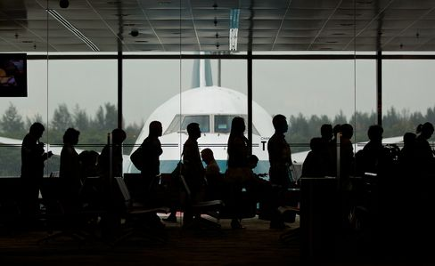 Passengers board a Cathay Pacific Boeing 747 airplane at Changi Airport in Singapore.