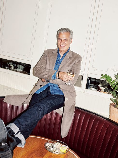Ripert relaxes at the Standard Grill in New York's Meatpacking District. Wool-and-cashmere cloth overcoat and denim slim-fit shirt by Brunello Cucinelli, $4,595 and $525; brunellocucinelli.com. Matchbox in Alpha jeans by AG, $198; agjeans.com. Tortoise heritage keyhole sunglasses by Ralph Lauren, $279; ralphlauren.com. Black calfskin Chelsea boots by Ralph Lauren, $750; ralphlauren.com