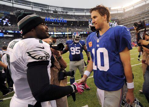 Quarterbacks Michael Vick & Eli Manning