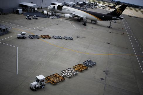 UPS Lowers 2014 Profit Outlook on Improvements to Peak Shipping