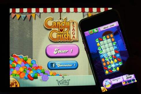 A Man Plays at Candy Crush Saga on his iPhone in Rome