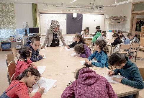 Refugee children are seen in a school in Halmstad, Sweden.