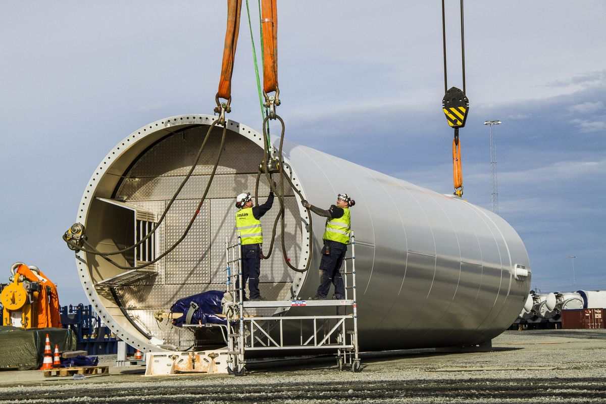Workers prepare a wind turbine tower, manufactured by Vestas Wind Systems A/S, in Esbjerg, Denmark. Photographer: Freya Ingrid Morales/Bloomberg