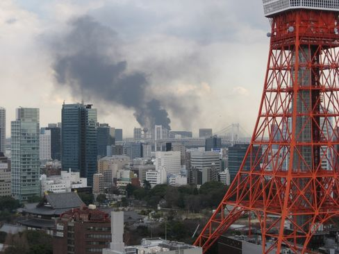 Smoke rises over Tokyo following the earthquake in March 2011.