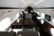 An employee sits inside a Gulfstream G450 business jet manufactured by Gulfstream Aerospace Corp., a unit of General Dynamics Corp., is seen at the Singapore Airshow held at the Changi Exhibition Centre in Singapore, on Wednesday, Feb. 17, 2016. Photographer: SeongJoon Cho/Bloomberg