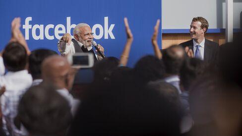 Narendra Modi, India's prime minister, speaks with Mark Zuckerberg at Facebook headquarters.