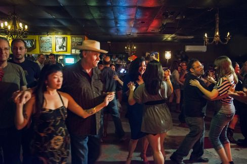 Patrons dance at The White Horse bar.