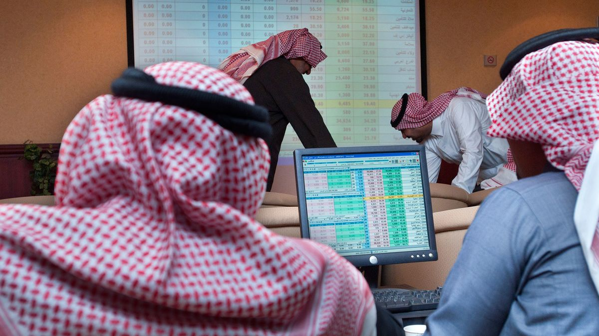 Investors watch share price movements in Riyadh, Saudi Arabia.