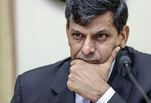 Raghuram Rajan, governor of the Reserve Bank of India (RBI), pauses during a news conference.