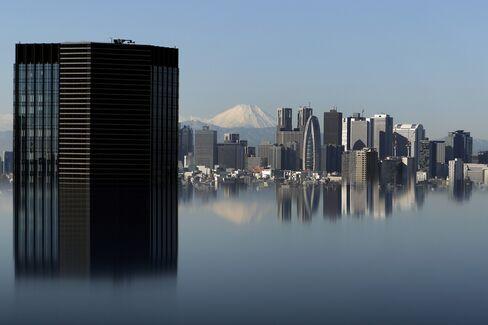 Mount Fuji and buildings in Tokyo. Photographer: Kiyoshi Ota/Bloomberg