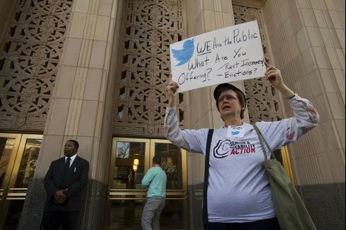 A Protester Holds a Sign Outside Twitter Inc.'s Headquarters