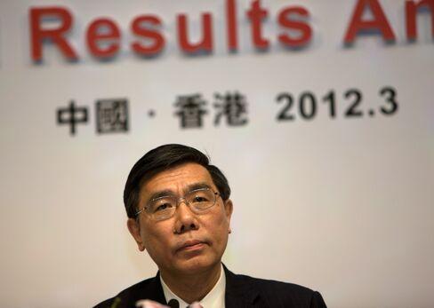 Record Profit Nets Jiang $308,000 Versus Dimon's $23 Million Pay