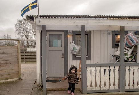 A little girl from Afghanistan leaves her temporary house in Halmstad, Sweden.