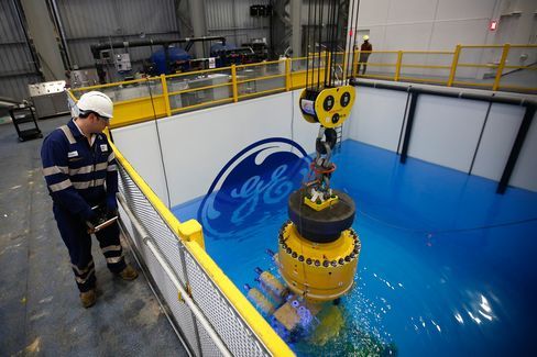 The company logo sits submerged in a testing pool at the General Electric Co. (GE) manufacturing plant in Montrose, U.K., on Wednesday, Dec. 11, 2013.