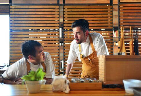 Paul Qui (left) and Jorge Luis Hernandez, chefs of Qui in Austin, Texas.