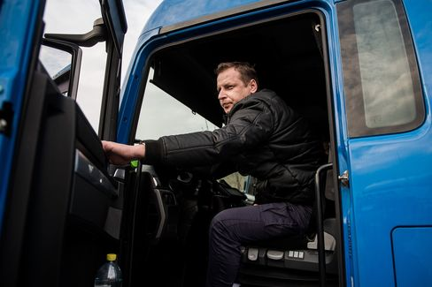 Zoltan Unczorg, a Hungarian truck driver, closes his truck door in the customs zone near the Austrian-German border.
