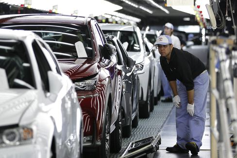 An employee inspects the paint finish of a Lexus NX SUV at the Miyata plant in Fukuoka Prefecture. Lexus has long prided itself for home-grown craftsmanship, with artisans on Japan assembly lines donning white gloves and honing years of factory experience before being entrusted to handle final inspections.