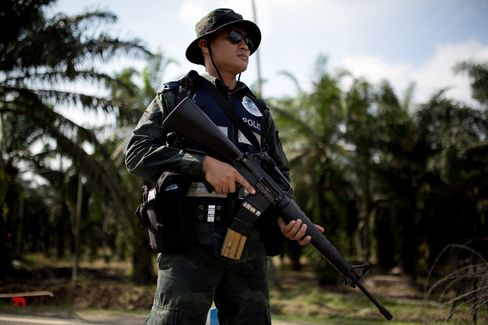 Malaysia Finds 13 Dead Insurgents as Muslim Clan Vows to Fight