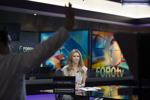 A Producer Signals to an Anchor at the Televisa Studios