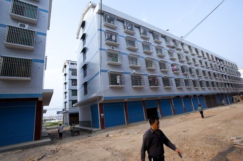 China Affirms Property Curbs Amid 'Grim' Outlook