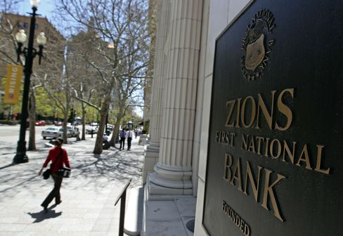 People Walk Past the Zions Bank Building in Salt Lake City