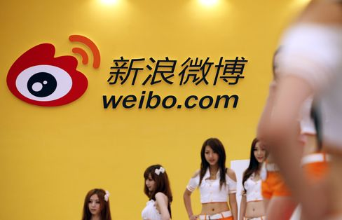Sina Extends Gains on Upgrade as Melco Advances