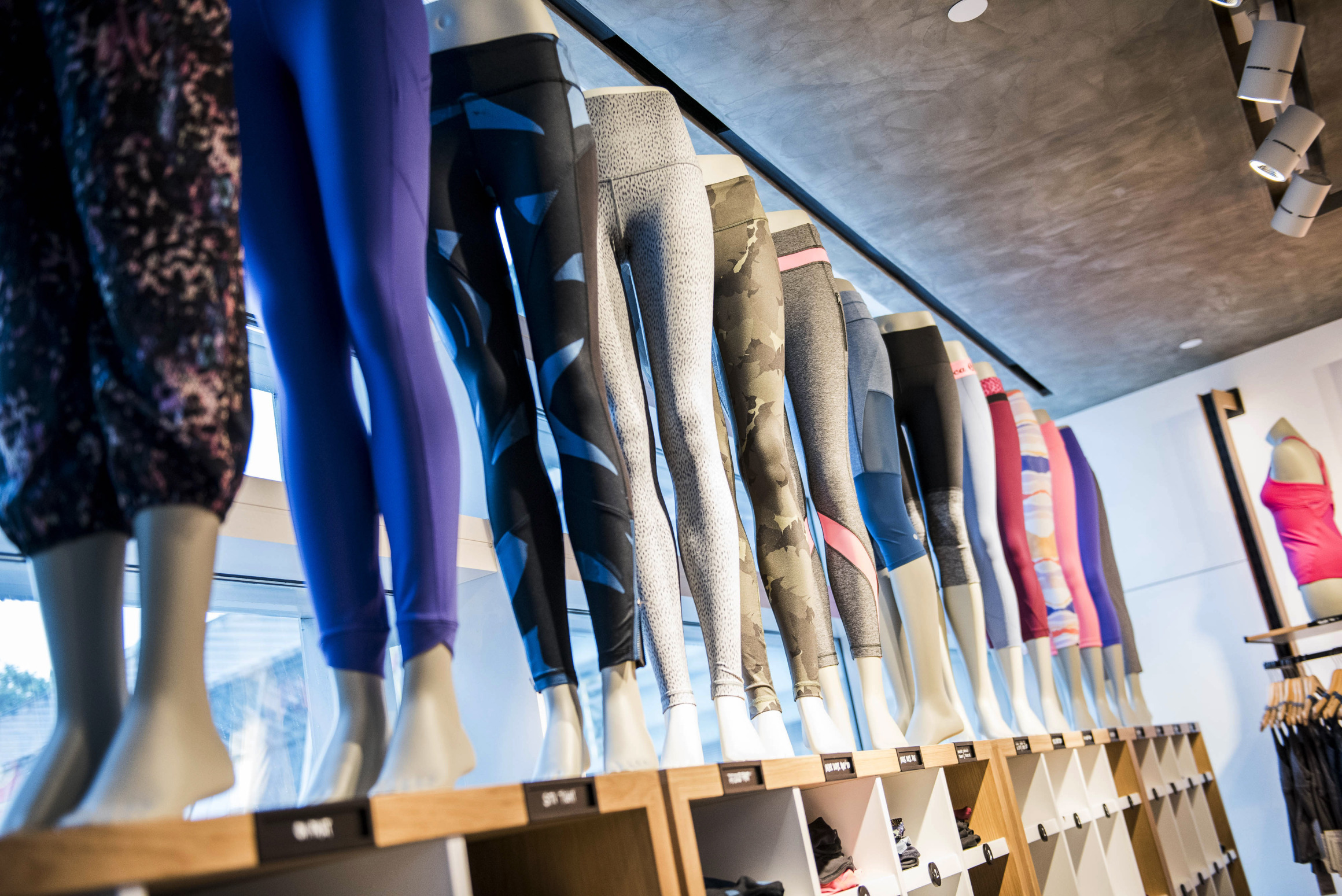 Athletic apparel sits on display inside a Lululemon Athletica Inc. store at International Finance Centre mall in Hong Kong, China, on Monday, June 22, 2015. Lululemon Athletica opened their first retail store in Hong Kong on June 19. Photographer: Xaume Olleros/Bloomberg